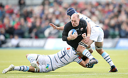 Saracen's Schalk Burger (centre) is tackled by Cardiff Blues' Olly Robinson (left) during the Heineken European Champions Cup, pool three match at Allianz Park, London.