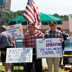 Protesters outside of a Town Hall Meeting with President Barack Obama, who was discussing health care reform legislation.  Portsmouth High School, Portsmouth, New Hampshire.