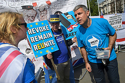 © Licensed to London News Pictures. 15/05/2019. London, UK. Remain campaigner STEVE BRAY (centre) is seen remonstrating with a Brexit Party supporter in Westminster, London. Government has announced that MPs will get another chance to vote on Theresa May's Brexit Bill in early June, after EU parliament elections. Photo credit: Ben Cawthra/LNP