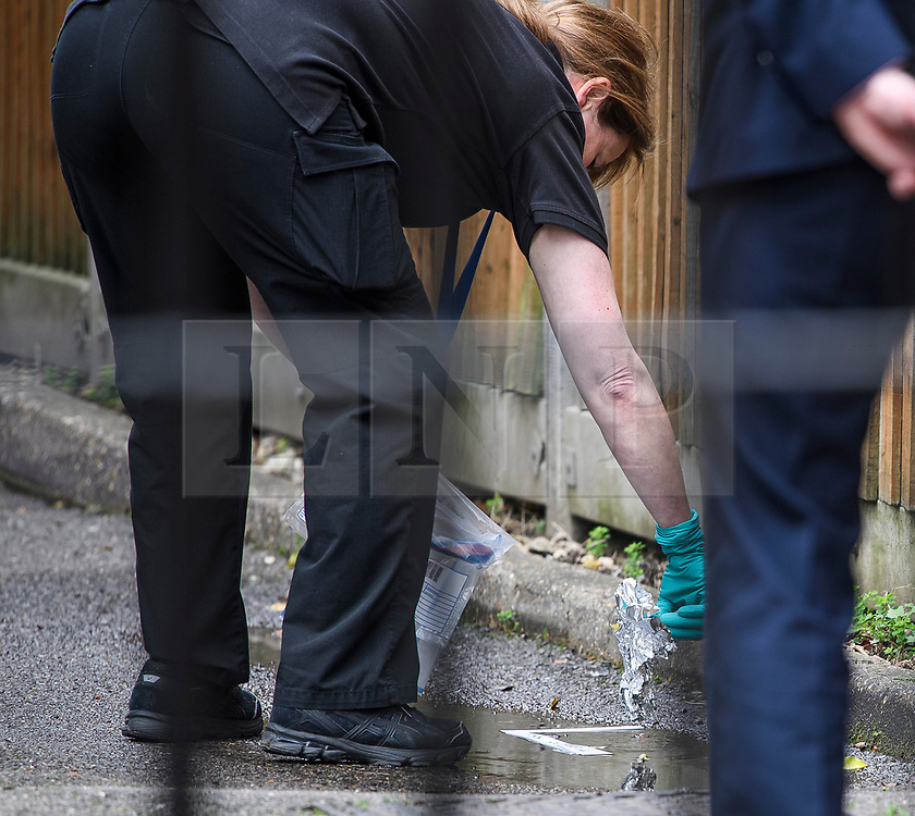 © Licensed to London News Pictures. 03/02/2020. London, UK. A police officer collecting evidence from the floor outside a bail hostel in Steatham, South London used by Sudesh Amman. A man, named as Sudesh Amman, was shot dead by police yesterday after a number of people were stabbed on Streatham High Road. Metropolitan Police declared the incident terrorist-related. Photo credit: Ben Cawthra/LNP