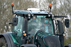 Farmer Stewart Chapman gives the Duke of Cambridge instructions on how to drive a tractor during a visit to Manor Farm in Little Stainton, Durham. Picture date: Tuesday April 27, 2021.