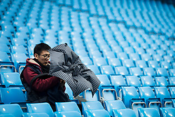 21st October 2017 - Premier League - Manchester City v Burnley - A fan struggles with his umbrella before the match - Photo: Simon Stacpoole / Offside.