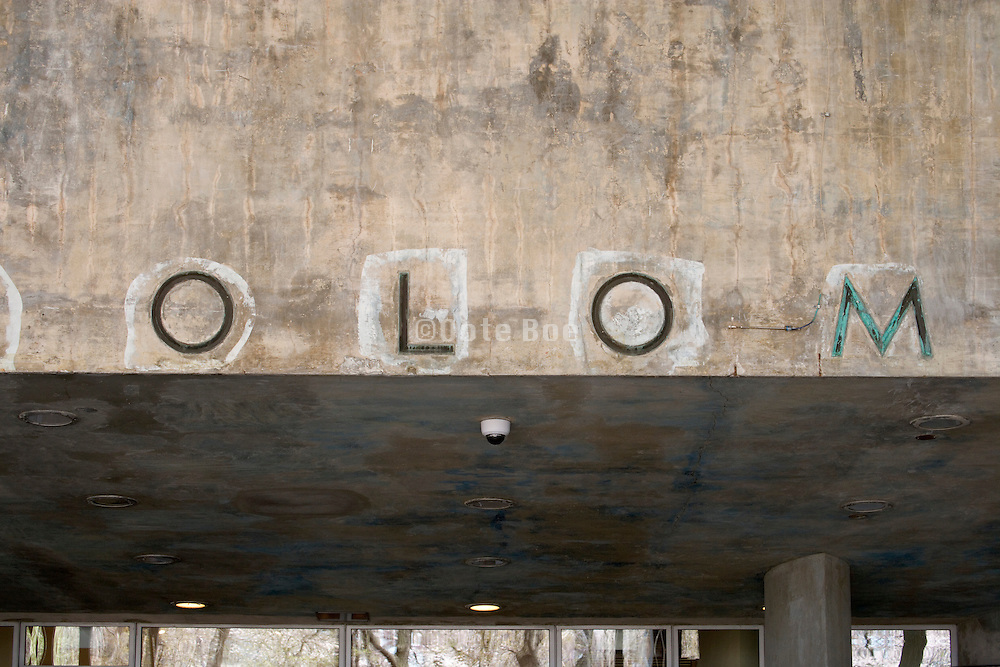 lettering on wall part of the Solomon R Guggenheim Museum in NYC during renovation
