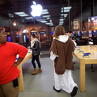 """After checking his social media accounts, Michael Grant, 28, """"Philly Jesus,"""" departs an Apple Store in Philadelphia, PA on December 14, 2014.  Nearly everyday for the last 8 months, Grant has dressed as Jesus Christ, and walked the streets of Philadelphia to share the Christian gospel by example.  He quickly acquired the nickname of """"Philly Jesus,"""" which he has gone by ever since."""