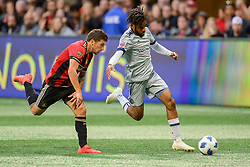 October 21, 2018 - Atlanta, GA, U.S. - ATLANTA, GA Ð OCTOBER 21:  Chicago's Raheem Edwards (7) moves the ball up the field with Atlanta's Eric Remedi (11) in pursuit during the match between Atlanta United and the Chicago Fire on October 21st, 2018 at Mercedes-Benz Stadium in Atlanta, GA.  Atlanta United FC defeated the Chicago Fire by a score of 2 to 1.  (Photo by Rich von Biberstein/Icon Sportswire) (Credit Image: © Rich Von Biberstein/Icon SMI via ZUMA Press)