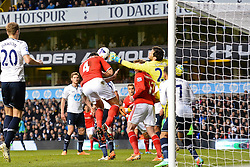 Tottenham's Hugo Lloris and Cardiff's Steven Caulker  compete for the ball - Photo mandatory by-line: Mitchell Gunn/JMP - Tel: Mobile: 07966 386802 02/03/2014 - SPORT - FOOTBALL - White Hart Lane - London - Tottenham Hotspur v Cardiff City - Premier League