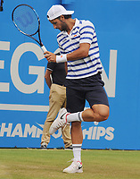 Tennis - 2017 Aegon Championships [Queen's Club Championship] - Day Six, Saturday<br /> <br /> Men's Singles, Semi Finals<br /> Grigor Dimitrov [Bul] vs. Feliciano Lopez [Esp]<br /> <br /> Feliciano Lopez checks for grass on his shoes on Centre Court <br /> <br /> COLORSPORT/ANDREW COWIE
