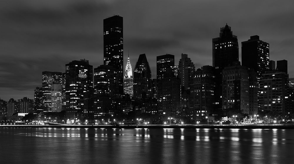 The Chrysler building shines in midtown manhattan; as seen from across the East River at Roosevelt Island.