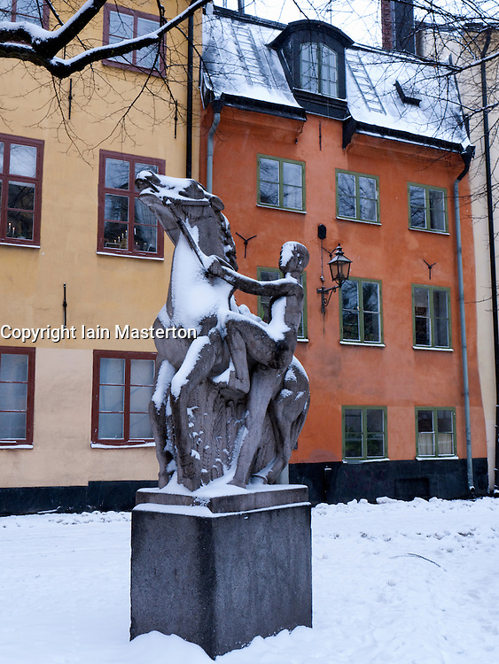 Statue in courtyard in Gamla Stan old town district in winter in Stockholm Sweden