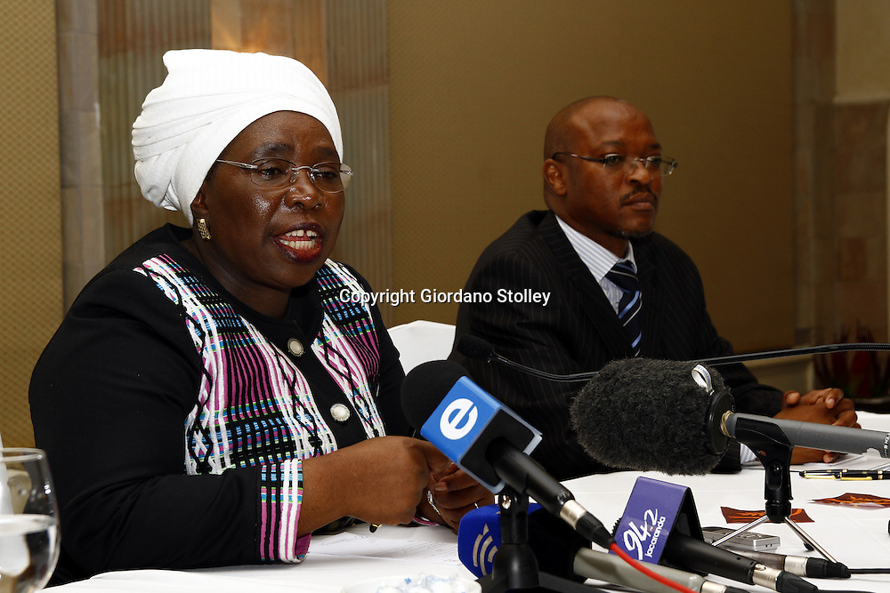 PRETORIA - 14 December 2010 - South Africa's home affairs minister Nkosazana Dlamini-Zuma addresses the media on the issuing of undocumented Zimbabwean's the necessary permits as director general Mkuseli Apleni looks on. -- APP/Allied Picture Press