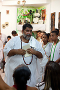 Master of ceremonies; Babalawo, conducting a worship Ceremony at Terreiro (yard) peace and love / Terreiro Paz y Amor, Salvador, Bahia, Brazil. Often the lines between Candomble, Catholicism and Umbanda are blurred. Salvador de Bahia is seen as the home of Candomble.
