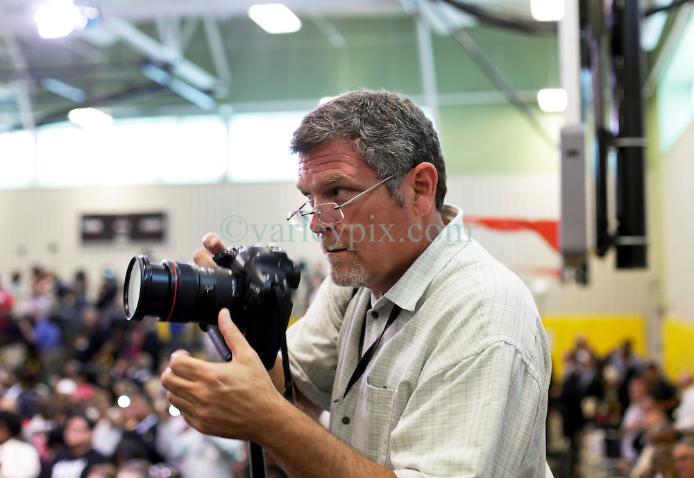 27 August 2015. Andrew P. Sanchez & Copelin-Byrd Multi Service Center, Lower 9th Ward, New Orleans, Louisiana.<br /> Photographer David Grunfeld of the Times Picayune prepares for a visit from President Obama.<br /> Photo credit©; Charlie Varley/varleypix.com.
