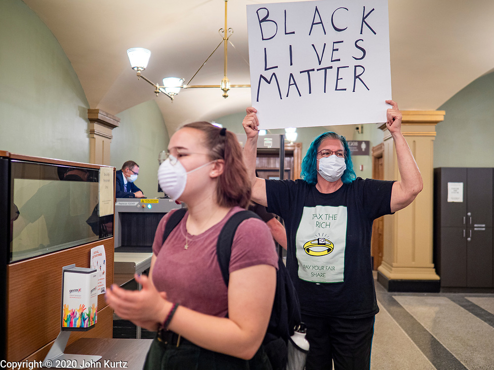 19 JUNE 2020 - DES MOINES, IOWA: Supporters of Black Lives Matter during a Juneteenth rally in the lobby of the Iowa State Capitol. About 100 supporters of Des Moines Black Lives Matter finished their week long series of protests at the Iowa State Capitol with a Juneteenth rally and demonstration. They are demanding that Gov. Kim Reynolds use an executive order to restore voting rights to felons who have completed their sentences. The protesters did not meet with the Governor Friday. The protest was peaceful.      PHOTO BY JACK KURTZ