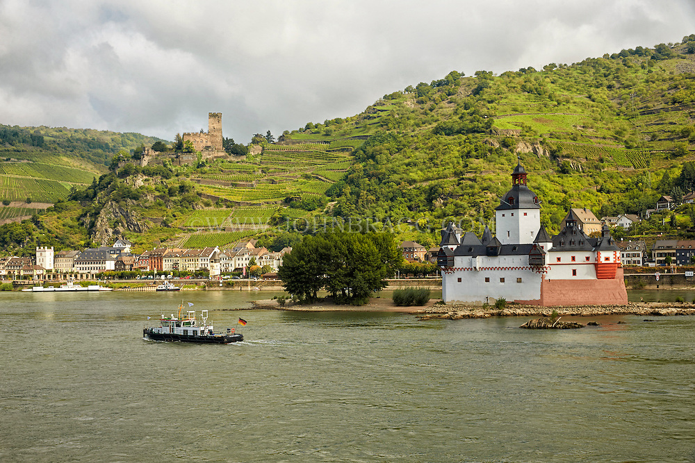 View from the Rhein of Pfalz and Gutenfels Castles, Vineyards, Hills, Housing and Tour Boats, Bacharach, Germany.