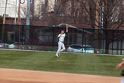 12 April 2014:  Jon Frericks pulls in a high fly ball in right center during an NCAA division 3 College Conference of Illinois and Wisconsin (CCIW) baseball game between the Augustana Vikings and the Illinois Wesleyan Titans at Jack Horenberger Stadium, Bloomington IL