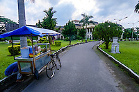 Indonesia, Sumatra. Medan. Istana Maimun Palace was built in 1888 by the sultan of Deli. His ancestors still occupy one wing of the building. A food stall.