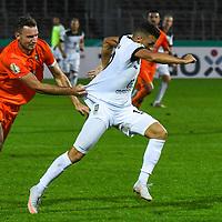 12.09.2020, Donaustadion, Ulm, GER, DFB Pokal, SSV Ulm 1846 Fussball vs FC Erzgebirge Aue, <br /> DFL REGULATIONS PROHIBIT ANY USE OF PHOTOGRAPHS AS IMAGE SEQUENCES AND/OR QUASI-VIDEO, <br /> im Bild Florian Ballas (Aue, #6) kann Ardian Morina (Ulm, #10) nur mit einem Foul (Halten am Trickot) stoppen<br /> <br /> Foto © nordphoto / Hafner