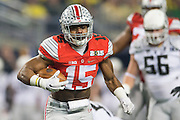Ezekiel Elliott #15 of the Ohio State Buckeyes breaks free against the Oregon Ducks during the College Football Playoff National Championship Game at AT&T Stadium on January 12, 2015 in Arlington, Texas.  (Cooper Neill for The New York Times)