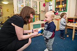 Pictured: Ms Todd got up close and personal with 18 moth old Carson Kerr.<br /> <br /> The Minister for Childcare and Early Years, Maree Todd visited North Edinburgh Childcare and Training centre today and welcomed the childcare deposit pilot. Ms Todd met staff and children at the centre to discuss the pilot.<br /> <br /> Ger Harley | Edinburgh Elite Media
