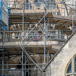 Stone mason working on the Gloucester cathedral during the coronavirus lockdown period