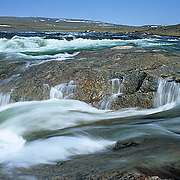 Northwest Territories, known as Nunuvat, Canada. Falls of Sila River running fast from summer run-off. Wager Bay.
