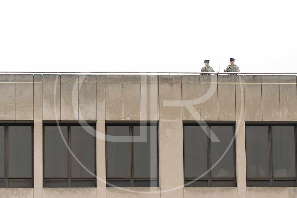Washington DC, United States - Two Marines observe Trump's 2017 inauguration from a higher vantage point.