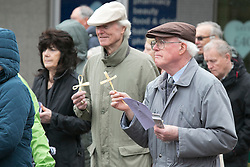 "© Licensed to London News Pictures. 3/4/2015. Solihull, West Midlands, UK. The Good Friday ""Walk of Witness"" taking place in Solihull. People of all faiths congrgate outside St Alphege Church and walk the short distance to Mell Square to hold a multi-faith prayer meeting. Pictured, people carrying crosses on the journey. Photo credit : Dave Warren/LNP"