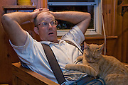 Joel Salatin, a farmer and author, relaxes after a long day at his farm in Virginia's Shenandoah Valley. (Joel Salatin is featured in the book What I Eat: Around the World in 80 Diets.)  MODEL RELEASED.