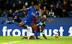 Michail Antonio of West Ham United goes down under the challenge from Wes Morgan of Leicester City - Mandatory by-line: Robbie Stephenson/JMP - 31/12/2016 - FOOTBALL - King Power Stadium - Leicester, England - Leicester City v West Ham United - Premier League