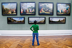 Visitor looks at paintings in famous Gemaldegallerie at the Kulturforum in Berlin Germany