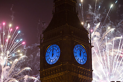 © Licensed to London News Pictures. 01/01/2016. London, UK. Fireworks explode behind Big Ben to mark the start of the New Year, 2016 Photo credit : Vickie Flores/LNP