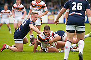 Bradford Bulls hooker Scott Moore (34) is tackled during the Kingstone Press Championship match between Swinton Lions and Bradford Bulls at the Willows, Salford, United Kingdom on 20 August 2017. Photo by Simon Davies.