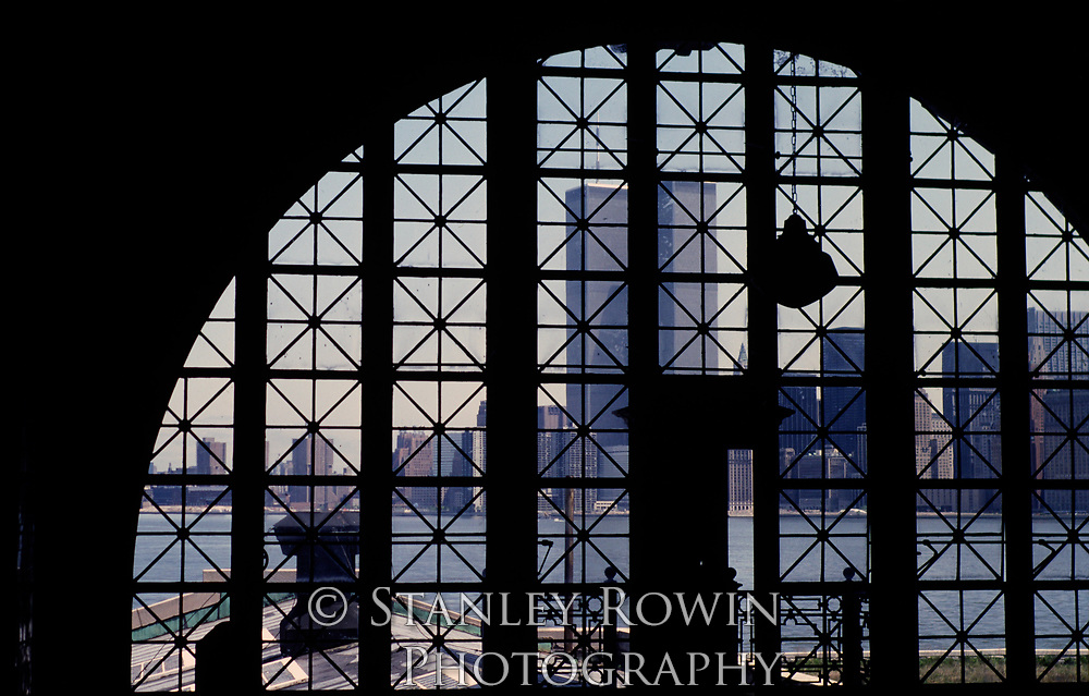 Archive Photo of Great Hall, Registry Room, Ellis Island, original World Trade Center's Twin Towers in background