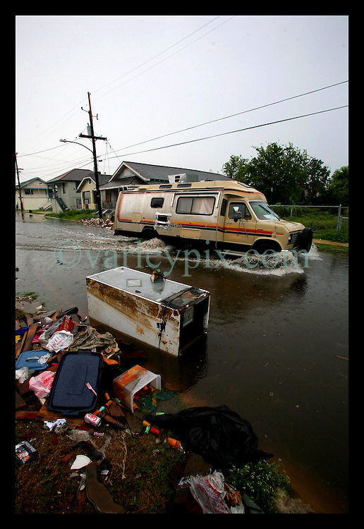 03 July 2006 - New Orleans - Louisiana. Flooding. Upper 9th ward. Rubble, trash and debris block drains on N. Dorgenois street where a rotting fridge floats in flood waters created by some of the heaviest downpours since hurricane Rita. The City remains unprepared to handle heavy flooding.