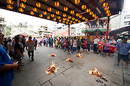 Ghost money is burned at a Taoist religious event in Tainan, Taiwan.
