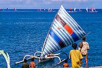 Nusa Tenggara, Lombok, Senggigi. Traditional fishingboats heading home in the morning.