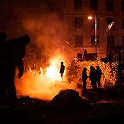 January 24, 2014 - Kiev, Ukraine: Protestors stand guard near a defensive barricade near Dynamo Kiev's stadium in central Kiev, as temperatures drop to minus 15 degrees celsius. (Paulo Nunes dos Santos)