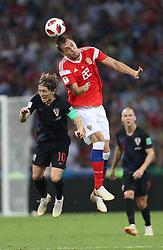 SOCHI, July 7, 2018  Artem Dzyuba (top) of Russia competes for a header with Luka Modric (L) of Croatia during the 2018 FIFA World Cup quarter-final match between Russia and Croatia in Sochi, Russia, July 7, 2018. (Credit Image: © Cao Can/Xinhua via ZUMA Wire)