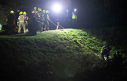 © Licensed to London News Pictures 19/01/2021.        Orpington, UK. The casualty is pulled up the river bank in a rescue stretcher. A person has been rescued from the River Cray in Orpington,South East London tonight (19.01.21) by The London Ambulance Hazardous Area Response Team along with firefighters from the London Fire Brigade.The condition of the person is unknown. Photo credit:Grant Falvey/LNP