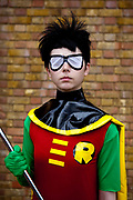Christel Dee as Robin from Teen Titans attending the London Film and Comic Con LFCC is a convention held annually in London that focuses on films, cult television and comics. The convention holds a large dealers hall selling movie, comic and science fiction related memorabiliaand original film props, along with free guest talks, professional photoshoots, autograph sessions, displays. Many of the visitors / attendeesarrive dressed up as their favourite comic and sci-fi characters in the most outlandish costumes which draws from the award-winning formula of innovative gameplay.<br /> Teen Titans is based on the DC Comics superhero team, and revolves around main team members Robin (the leader), Raven, Starfire, Beast Boy, and Cyborg. While it is an action cartoon, the series is also character-driven, with a focus on the main characters' struggles with being teenage superheroes, their mutual friendships, and their limitations