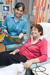 Nurse going through an NHS leaflet with a patient on the Nottingham City Hospital Renal Unit,