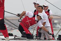 Cameron Dunn, Yasuhiro Yaji (crouching), Thierry Douillard, Peter Gilmour. Korea Match Cup 2010. World Match Racing Tour. Gyeonggi, Korea. 12th June 2010. Photo: Ian Roman/Subzero Images.