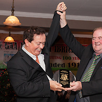 Chairman of the Kilmurry Ibrickane Centenary Committee Michael Talty presents an award to Quilty man and recent Clare man of the year, Marty Morrissey, during the Kilmurry Ibrickane GAA Club Centenary Closing Ceremony