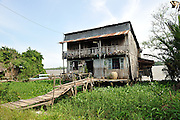 Wooden house on banks of Mekong River, Coconut Island (Con Phung), My Tho, Ben Tre province, Vietnam