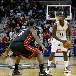 Oct 23, 2013; New Orleans, LA, USA; New Orleans Pelicans point guard Jrue Holiday (11) is guarded by Miami Heat small forward LeBron James (6) during the first half of a preseason game at New Orleans Arena. Mandatory Credit: Derick E. Hingle-USA TODAY Sports