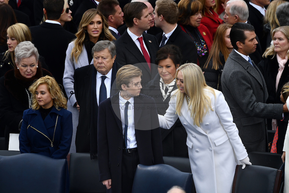 Tiffany Trump greets her half-brother Baron Trump during the President Inaugural Ceremony on Capitol Hill January 20, 2017 in Washington, DC. Donald Trump became the 45th President of the United States in the ceremony.