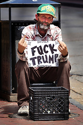 April 3, 2017 - Memphis, Tennessee, USA - A beggar sits on Bourbon Street in the French Quarter asking for money and protesting Donald Trump. (Credit Image: © Karen Focht via ZUMA Wire)