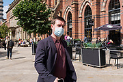 A man in a suit wearing a blue surgical face covering to prevent the spread of Covid-19 on 10th August, 2021 in Leeds, United Kingdom. The British Department of Health has announced that as of Monday, new guidance will mean that even the fully vaccinated will be advised to wear a mask and limit their contact with others if they come into contact with somebody who tests positive for Coronavirus.