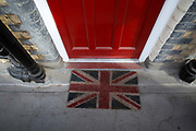 A Union Jack doormat in Somers Town on 26th June 2016 in London, United Kingdom. Somers Town, a district in north west London, is a large housing estate nestled between Euston, St Pancras and Kings Cross Library. Predominantly filled with social housing for the past 200 years, much of the area's housing was built in the twentieth century by the local authority.