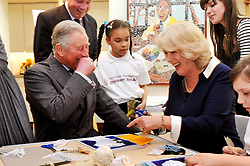 File photo dated 15/03/12 of the Prince of Wales and the Duchess of Cornwall laughing as they produce artwork, during a visit to the Dulwich Picture Gallery in south London. Charles and Camilla are celebrating their 15th wedding anniversary on Friday, after they were reunited on Monday when the 72-year-old duchess came out of a 14-day self-isolation on the Balmoral estate in Aberdeenshire.
